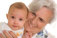Gammalare kvinna och nyfött Fotografering för Bildbyråer