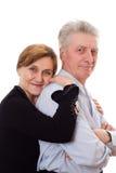 Gammalare kvinna som kramar en man Royaltyfri Bild