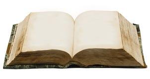 Gammalt öppna boken på en vit bakgrund med ingen text Arkivfoto