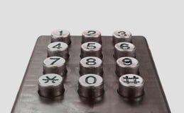Gammalt använt telefontangentbord på vit bakgrund Arkivfoton