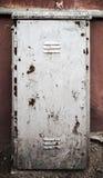 Gammalt belägga med metall dörren texturerar fotografering för bildbyråer