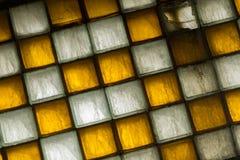 Gammalt fönster av fyrkantiga tegelplattor Royaltyfria Bilder