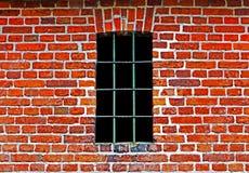Gammalt fönster med stänger i tegelstenvägg Royaltyfri Fotografi