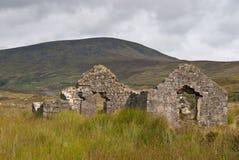 gammalt fördärvar stenen Arkivbild