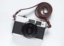 Gammalt filma kameran Vit bakgrundsnärbild för fotostruktur för abstrakt bakgrund homogen tappning royaltyfri fotografi