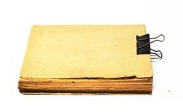 Gammalt forntida bokar, tomt täcker sidor av en boka med cilp royaltyfri foto