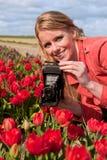 gammalt foto för blond flicka för kamera holländsk Royaltyfria Bilder