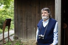 Gammalt fotografanseende på träbakgrund arkivfoto