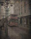 Gammalt fotografi av en buss arkivfoton