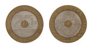 Gammalt franskt mynt som isoleras på White Arkivbilder
