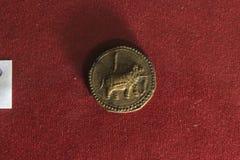 Gammalt indiskt mynt Arkivbild