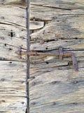 gammalt lantligt trä för dörr Arkivfoto