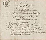 Gammalt manuskript med calligraphic handskriven text Arkivbilder