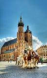 Gammalt marknadsföra kvadrerar i Krakow, Polen Royaltyfria Bilder