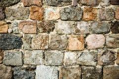 Gammalt medeltida gör envist motstånd, komponerade av stora massiva stenkvarter, som abstrakt sömlös texturbakgrund Arkivbild