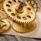 Gammalt mekaniskt klockakugghjul Arkivbild