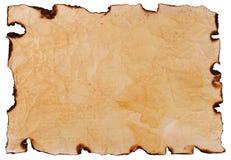 Gammalt papper med de brända kanterna Arkivbilder