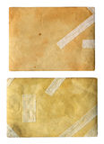Gammalt papper med spår av återställande. Arkivfoto