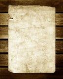 Gammalt papper på brun Wood texturSepia royaltyfri bild