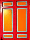 Gammalt rött och gult fönster Fotografering för Bildbyråer