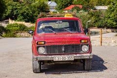 Gammalt rött taxar Fotografering för Bildbyråer