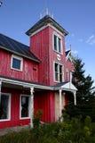 gammalt rött västra för hus arkivfoto