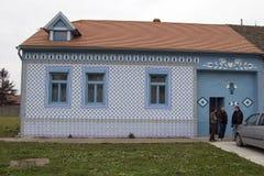 Gammalt rappade tegelplattor för by hus Fotografering för Bildbyråer