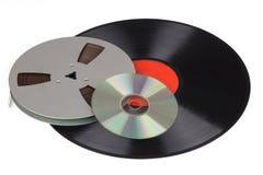 Gammalt rekord, bandrulle med en musikCD arkivbilder