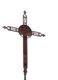 Gammalt rostat kors, kors som isoleras på vit Arkivfoto