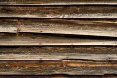 gammalt sidingträ för ladugård Arkivbilder