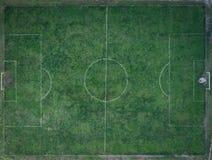 Gammalt smutsigt fotbollfält Royaltyfri Foto