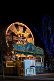 Gammalt snurrferrishjul på barns jul som är ganska i Graz royaltyfria bilder