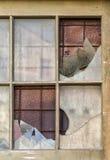 Gammalt sprucket glass fönster Royaltyfri Bild