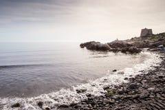 Gammalt stena watchtoweren i almunecar Spanien fotografering för bildbyråer