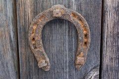 gammalt trä för forntida bakgrundshästsko Royaltyfri Bild