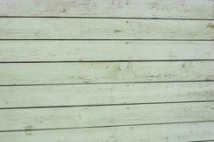 gammalt trä för staket Textur av naturligt åldrigt ljus - grönt staket med sprucken målarfärg close upp royaltyfri illustrationer