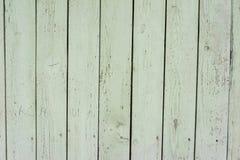 gammalt trä för staket Textur av naturligt åldrigt ljus - grönt staket med sprucken målarfärg close upp vektor illustrationer