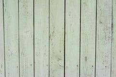 gammalt trä för staket Textur av naturligt åldrigt ljus - grönt staket med sprucken målarfärg close upp stock illustrationer