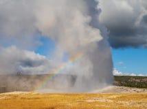 Gammalt troget och en regnbåge arkivfoto