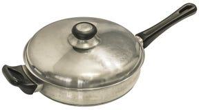Gammalt tungt rostfritt stål som sliter Pan With Lid Isolated On vitbakgrund Arkivfoto