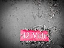 Gammalt 12 volt tecken 3 Arkivbilder