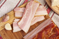 Gammon of bacon on the cutting board. Royalty Free Stock Images