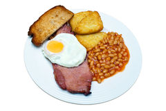 Gammon Egg and Beans. Gammon, fried egg, beans, hash browns and fried bread on an isolated white background with a clipping path Royalty Free Stock Photos