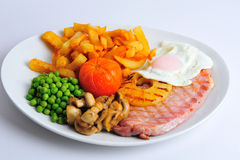Gammon egg and Chips. Cooked meal stock photography