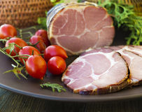 Gammon ham with tomotoes and juniper Royalty Free Stock Photos
