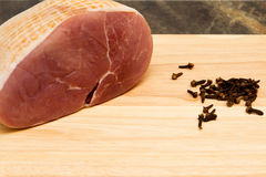 Gammon joint. A raw gammon joint studded with cloves Royalty Free Stock Images