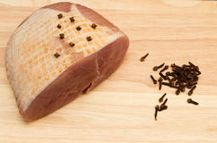 Gammon joint. A raw gammon joint studded with cloves Royalty Free Stock Image