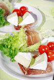 Gammon on salad with cheese Royalty Free Stock Photo