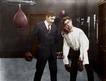 Ganador y perdedor en combate de boxeo (todas las personas representadas no son vivas más largo y ningún estado existe Garantías  imagen de archivo