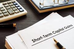 Ganancias sobre el capital a corto plazo STCG fotografía de archivo